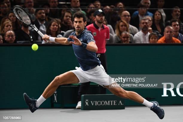 Serbia's Novak Djokovic returns the ball to Russia's Karen Khachanov during their men's singles final tennis match on day seven of the ATP World Tour...