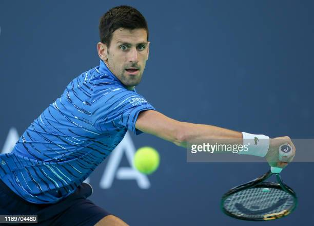 TOPSHOT Serbia's Novak Djokovic returns the ball to Russia's Karen Khachanov during the Mubadala World Tennis Championship 3rd Place match at Zayed...