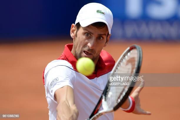 Serbia's Novak Djokovic returns the ball to Slovakia's Martin Klizan during their Barcelona Open ATP tournament tennis match in Barcelona on April...