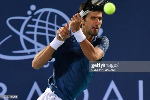 Serbia's Novak Djokovic returns the ball to South Africas Kevin Anderson during the Mubadala World Tennis Championship 2018 final match in Abu Dhabi...