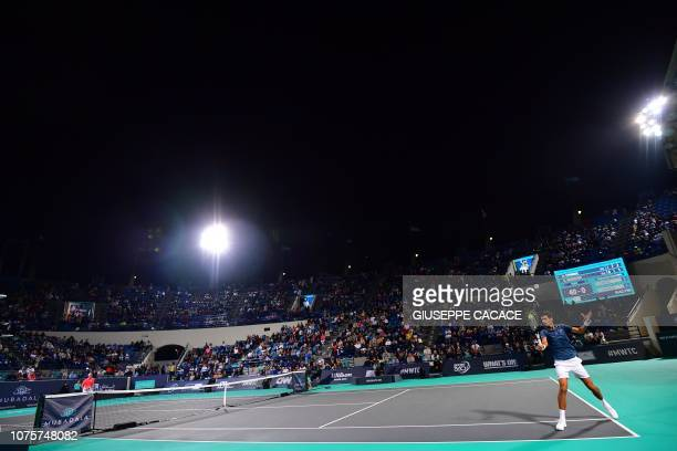 Serbia's Novak Djokovic returns the ball to South Africas Kevin Anderson during the Mubadala World Tennis Championship 2018 final match in Abu Dhabi...