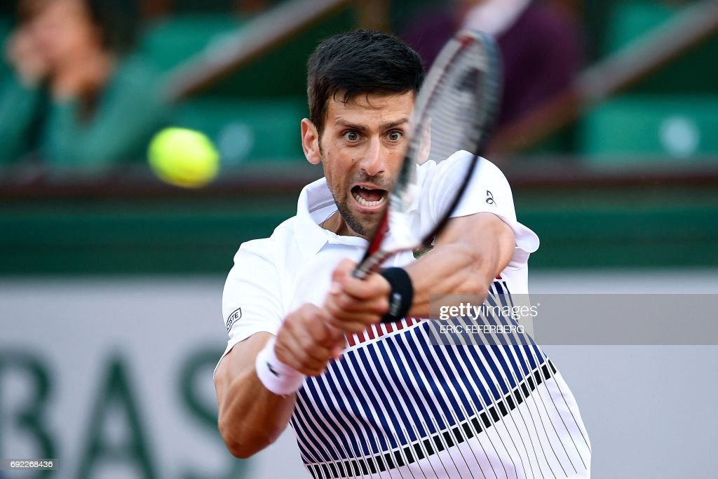 Serbia's Novak Djokovic returns the ball to Spain's Albert Ramos-Vinolas during their tennis match at the Roland Garros 2017 French Open on June 4, 2017 in Paris. / AFP PHOTO / Eric FEFERBERG