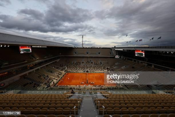Serbia's Novak Djokovic returns the ball to Spain's Pablo Carreno Busta during their men's singles quarter-final tennis match at the Philippe...
