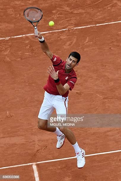 Serbia's Novak Djokovic returns the ball to Spain's Roberto Bautista-Agut during their men's fourth round match at the Roland Garros 2016 French...