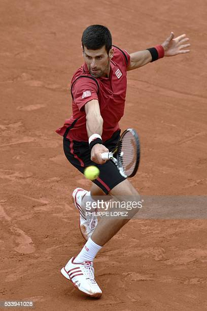 TOPSHOT Serbia's Novak Djokovic returns the ball to Taiwan's Lu YenHsun during their men's first round match at the Roland Garros 2016 French Tennis...