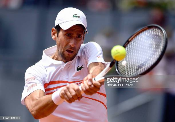 Serbia's Novak Djokovic returns the ball to US Taylor Fritz during their ATP Madrid Open round of 64 tennis match at the Caja Magica in Madrid on May...