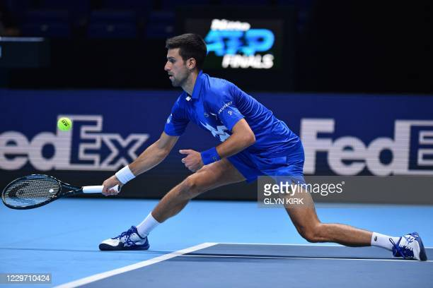 Serbia's Novak Djokovic returns to Austria's Dominic Thiem during their men's singles semi-final match on day seven of the ATP World Tour Finals...