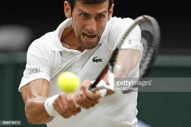 Serbia's Novak Djokovic returns to Spain's Rafael Nadal during the continuation of their men's singles semifinal match on the twelfth day of the 2018...