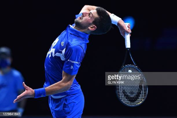 Serbia's Novak Djokovic serves against Argentina's Diego Schwartzman in their men's singles round-robin match on day two of the ATP World Tour Finals...