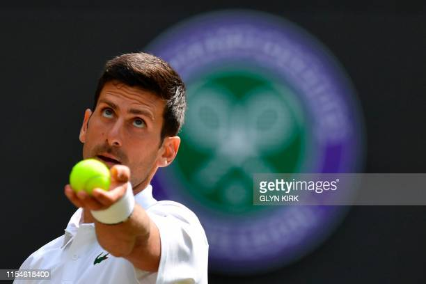 Serbia's Novak Djokovic serves against France's Ugo Humbert during their men's singles fourth round match on the seventh day of the 2019 Wimbledon...