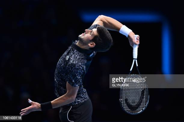 Serbia's Novak Djokovic serves against Germany's Alexander Zverev during their mens singles roundrobin match on day four of the ATP World Tour Finals...