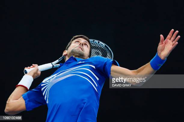TOPSHOT Serbia's Novak Djokovic serves against Spain's Rafael Nadal during the men's singles final on day 14 of the Australian Open tennis tournament...