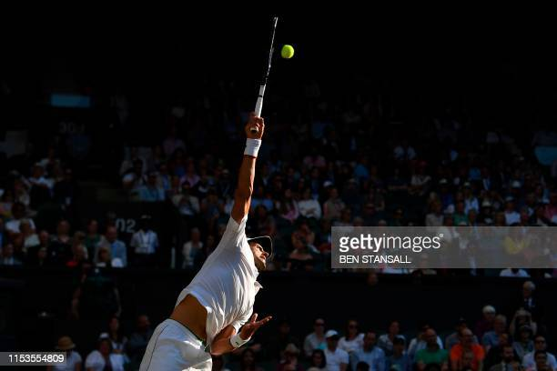 Serbia's Novak Djokovic serves against US player Denis Kudla during their men's singles second round match on the third day of the 2019 Wimbledon...