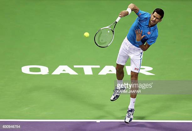 Serbia's Novak Djokovic serves the ball to Argentina's Horacio Zeballos during the second round of the ATP Qatar Open tennis competition in Doha on...