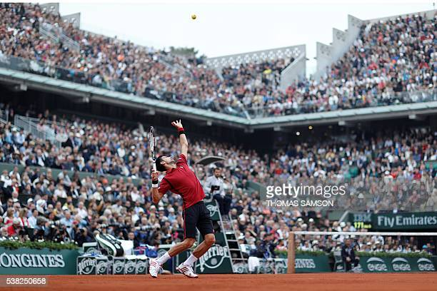 TOPSHOT Serbia's Novak Djokovic serves the ball to Britain's Andy Murray during their men's final match at the Roland Garros 2016 French Tennis Open...