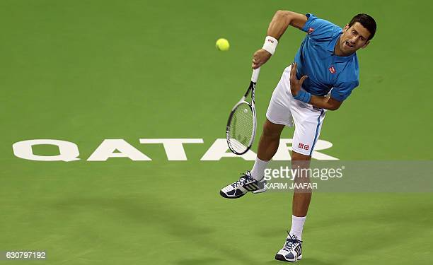 Serbia's Novak Djokovic serves the ball to JanLennard Struff of Germany during the ATP Qatar Open tennis competition in Doha on January 2 2017 / AFP...