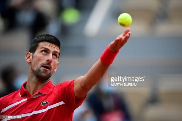 Serbia's Novak Djokovic serves the ball to Lithuania's Ricardas Berankis during their men's singles second round tennis match on Day 5 of The Roland...