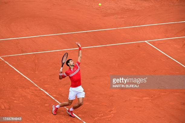 Serbia's Novak Djokovic serves the ball to Lithuania's Ricardas Berankis during their men's singles third round tennis match on Day 7 of The Roland...