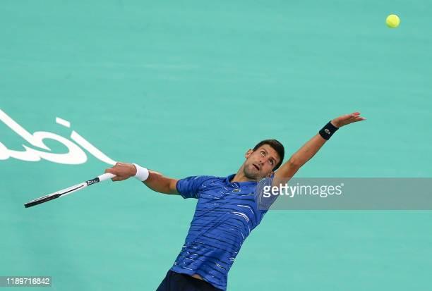 Serbia's Novak Djokovic serves the ball to Russia's Karen Khachanov during the Mubadala World Tennis Championship 3rd Place match at Zayed Sports...