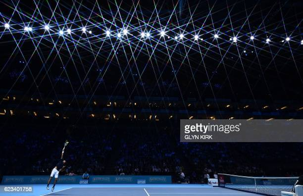 TOPSHOT Serbia's Novak Djokovic serves to Canada's Milos Raonic during their round robin stage men's singles match on day three of the ATP World Tour...