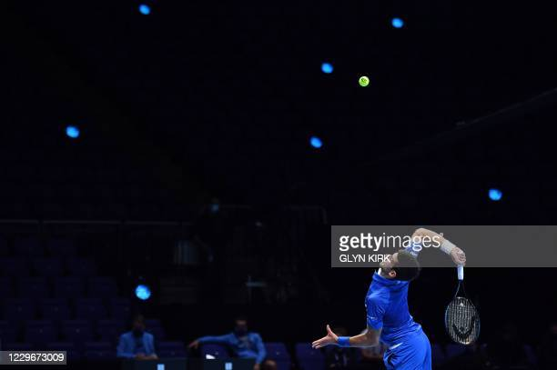 Serbia's Novak Djokovic serves to Russia's Daniil Medvedev during their men's singles round-robin match on day four of the ATP World Tour Finals...