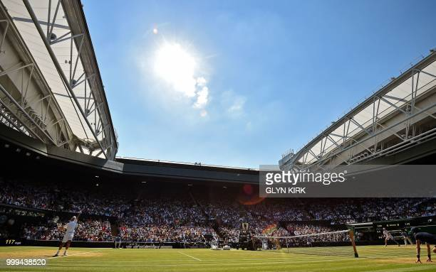Serbia's Novak Djokovic serves to South Africa's Kevin Anderson in their men's singles final match on the thirteenth day of the 2018 Wimbledon...