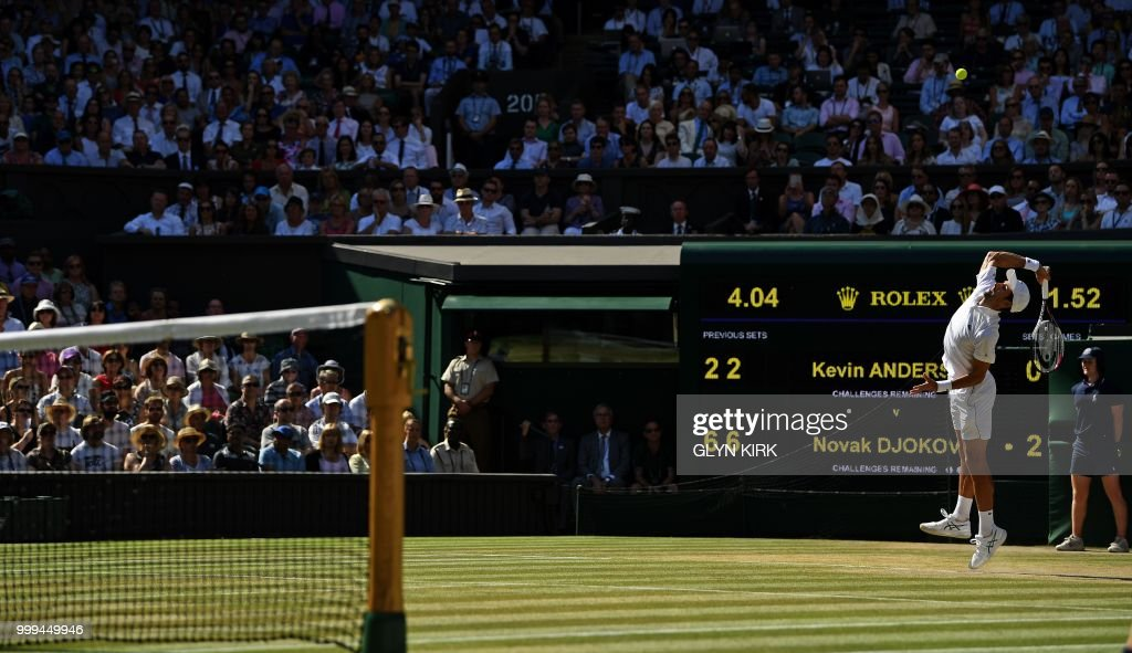 Serbia's Novak Djokovic serves to South Africa's Kevin Anderson in their men's singles final match on the thirteenth day of the 2018 Wimbledon Championships at The All England Lawn Tennis Club in Wimbledon, southwest London, on July 15, 2018. (Photo by Glyn KIRK / AFP) / RESTRICTED