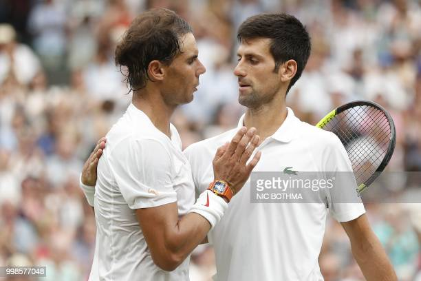 Serbia's Novak Djokovic shakes hands after beating Spain's Rafael Nadal during the continuation of their men's singles semifinal match on the twelfth...