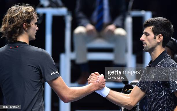 Serbia's Novak Djokovic shakes hands at the net with Germany's Alexander Zverev after Djokovic won their mens singles roundrobin match on day four of...