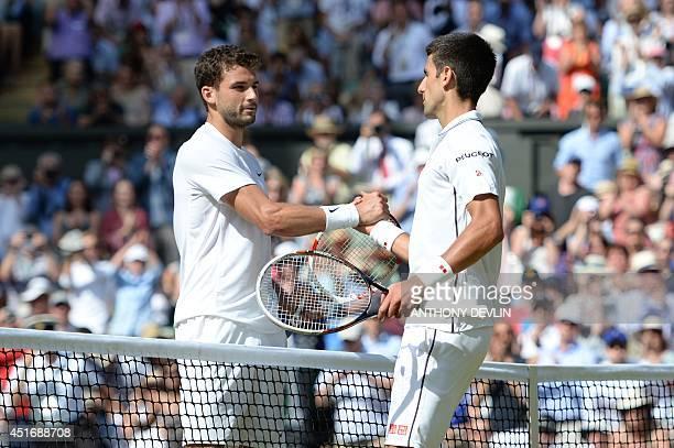 Serbia's Novak Djokovic shakes hands with Bulgaria's Grigor Dimitrov after Djokovic won their men's singles semifinal match on day 11 of the 2014...