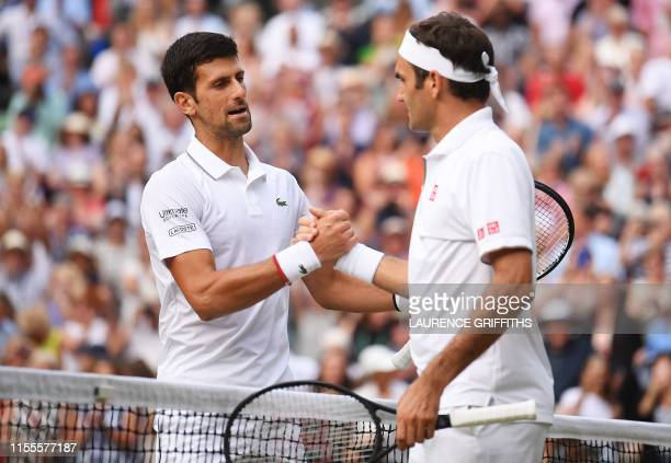 Serbia's Novak Djokovic shakes hands with Switzerland's Roger Federer after beating him during their men's singles final on day thirteen of the 2019...