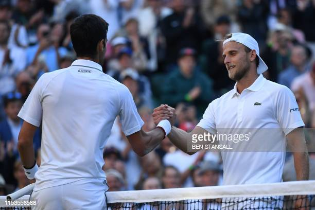Serbia's Novak Djokovic shakes hands with US player Denis Kudla after Djokovic won their men's singles second round match on the third day of the...