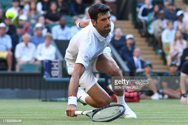 Serbia's Novak Djokovic slips over reaching for a return against US player Denis Kudla during their men's singles second round match on the third day...
