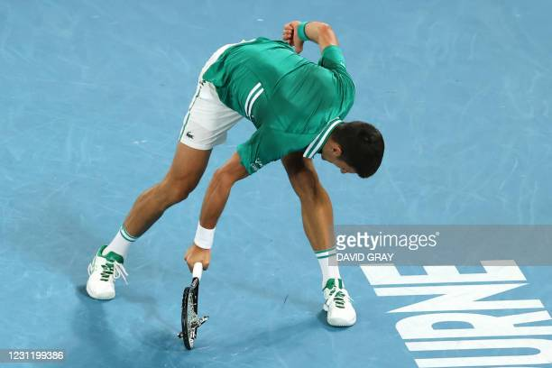 Serbia's Novak Djokovic smashes his racquet as he plays against Germany's Alexander Zverev during their men's singles quarter-final match on day nine...