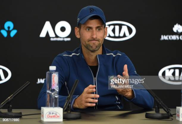 Serbia's Novak Djokovic speaks during a press conference after his loss to South Korea's Hyeon Chung in their men's singles fourth round match on day...