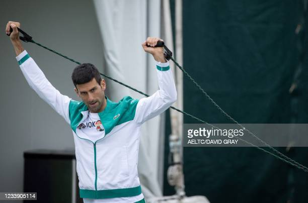 Serbia's Novak Djokovic stretches at the Aorangi Practice Courts on the twelfth day of the 2021 Wimbledon Championships at The All England Tennis...