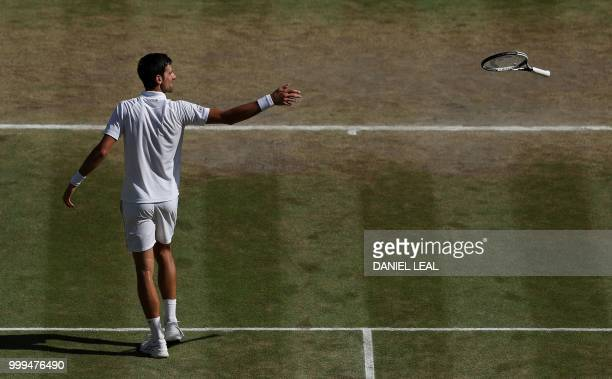 Serbia's Novak Djokovic throws his racket after beating South Africa's Kevin Anderson 62 62 76 in their men's singles final match on the thirteenth...