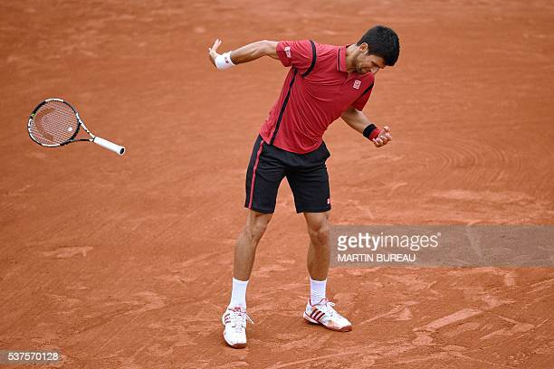 Serbia's Novak Djokovic throws his racket during his men's quarterfinal match against Czech Republic's Tomas Berdych at the Roland Garros 2016 French...
