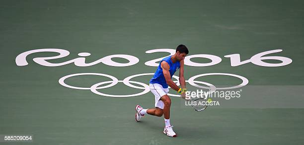 TOPSHOT Serbia's Novak Djokovic trains at the Olympic Tennis Centre in Rio de Janeiro Brazil on August 2 ahead of the Rio 2016 Olympic Games / AFP /...