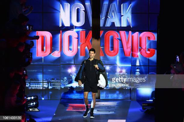 Serbia's Novak Djokovic walks on court to play against Germany's Alexander Zverev during their mens singles round-robin match on day four of the ATP...