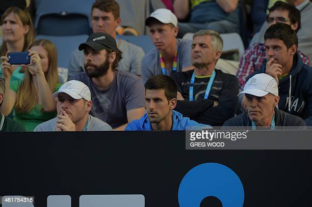 Serbia's Novak Djokovic watches compatriot Filip Krajinovic during his men's singles match against Australia's Sam Groth on day one of the 2015...