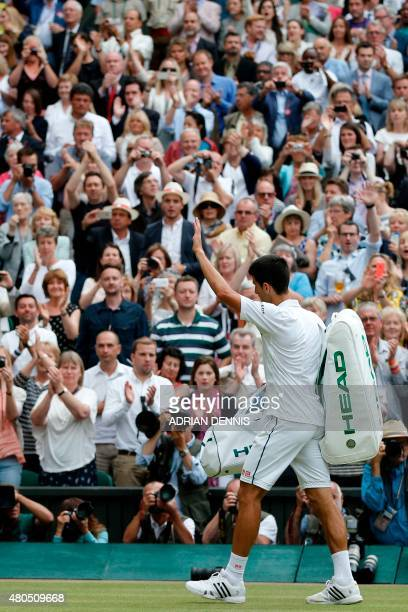 Serbia's Novak Djokovic waves to the crowd as he leaves the court after beating Switzerland's Roger Federer during their men's singles final match on...