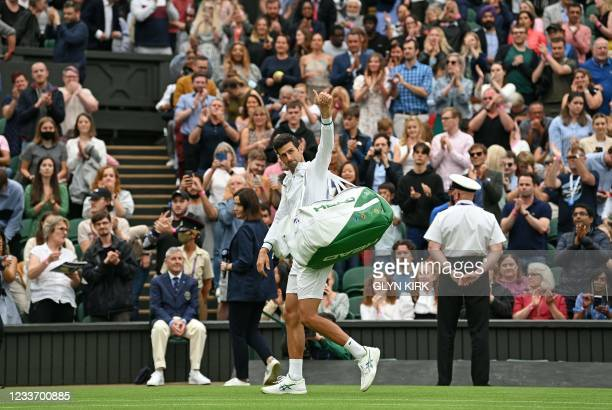 Serbia's Novak Djokovic waves to the spectators as he leaves after winning against Britain's Jack Draper during their men's singles first round match...