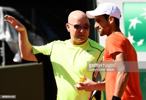 serbia's player Novak Djokovic and his coach Andre Agassi attend a training session ahead of the Roland Garros 2017 French Tennis Open on May 26 2017...