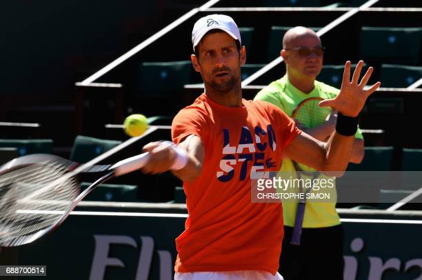 Serbia's player Novak Djokovic and his coach Andre Agassi of the US attend a training session ahead of the Roland Garros 2017 French Tennis Open on...