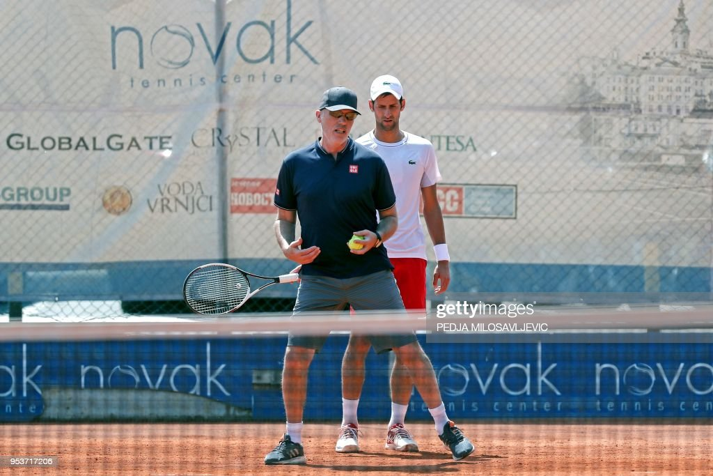 Serbia's player Novak Djokovic attends a training session with his fitness coach Gebhard Phil-Gritsch (L) in Belgrade, Serbia on May 2, 2018.