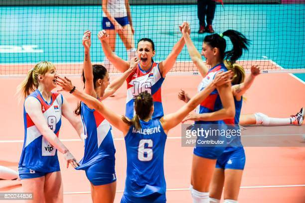 Serbia's player react after scoring a point during the Women's Volleyball World Grand Prix match between Russia and Serbia in Hong Kong on July 21...