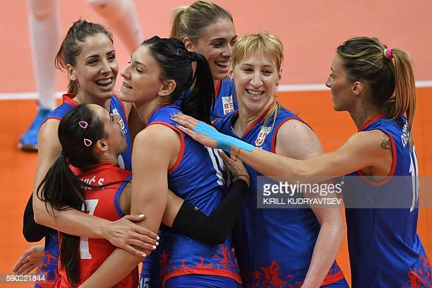 Serbia's players celebrate a point during the women's quarterfinal volleyball match between Russia and Serbia at the Maracanazinho stadium in Rio de...