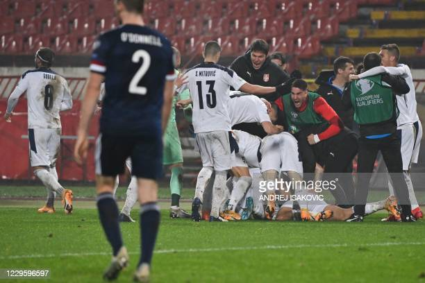 Serbia's players celebrate after scoring a goal during the Euro 2020 play-off qualification football match between Serbia and Scotland at the Red...