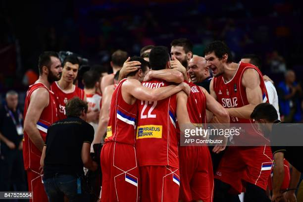 Serbia's players celebrate after winning the FIBA Eurobasket 2017 men's Semi Final basketball match between Russia and Serbia at Sinan Erdem Sport...